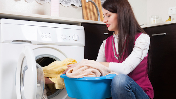 brunette woman doing laundry